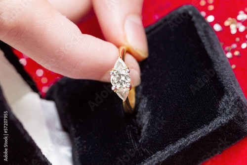 Taking Diamond Ring out of Jewelry Box