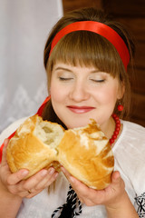 Woman smelling freshly made bread