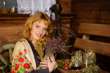 woman prepares dry herbs