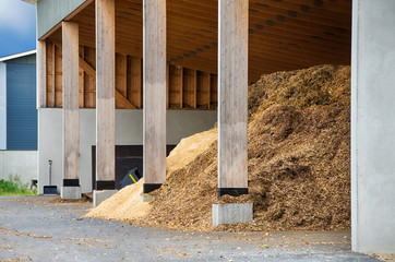 Wood chips waiting to be turned into biofuel for heating