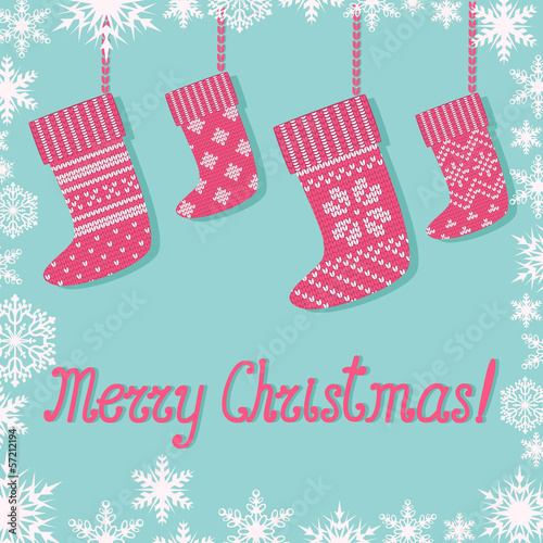 Christmas greeting with Christmas socks and snowflakes