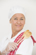 Confident happy female chef portrait
