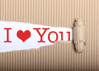 I love you text on paper and torn cardbox