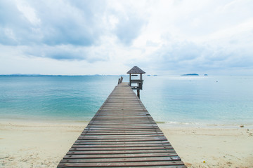 Wooden bridge into the sea.