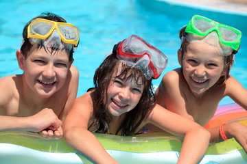 Happy children in swimming pool