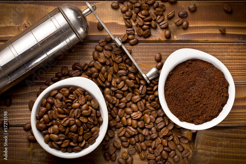 coffee beans with ground coffee and grinder