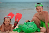 Boys with toy on beach