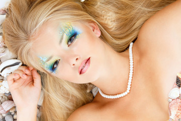 fresh attractive teenager girl mermaid with beautiful make-up