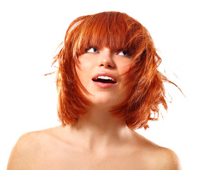 portrait of young beautiful redheaded woman looking up into the