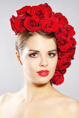 Portrait of smiling girl with red roses hairstyle
