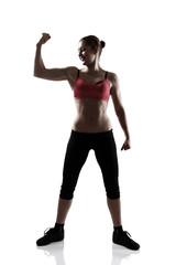 sport woman show biceps, full length portrait, silhouette studio