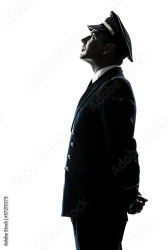 man in airline pilot uniform silhouette - 57215373