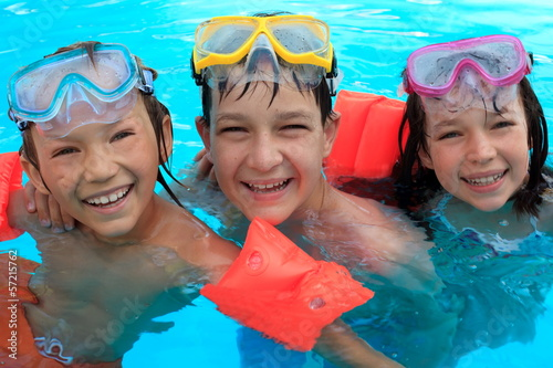 Trio of Happy Children in Swimming Pool