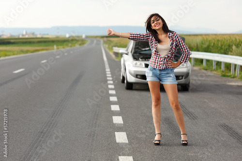 Woman driver hitch-hiking