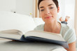 Close up of a short-haired woman reading a book