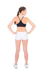 Rear view of fit woman in sportswear