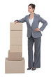 Confident businesswoman posing with cardboard boxes