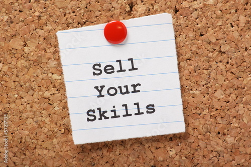 Sell Your Skills paper note on a cork notice board