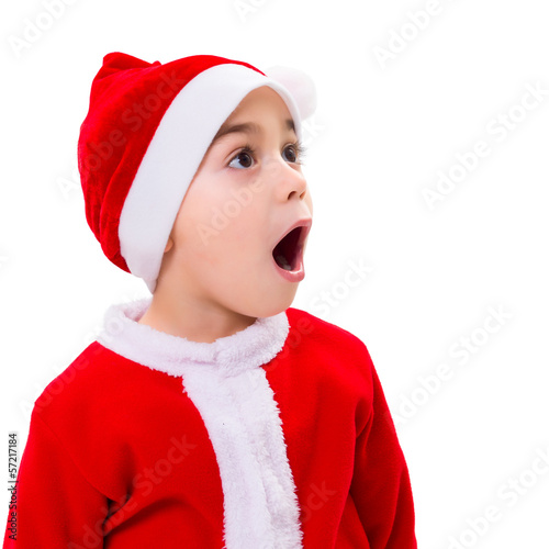 Surprised Christmas boy wondering
