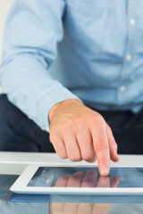 Close up of casual man using tablet