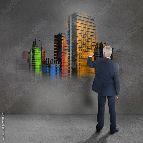 Rear view of mature businessman looking at grey wall