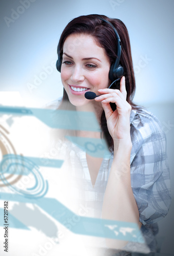 Smiling woman with headset using futuristic interface hologram