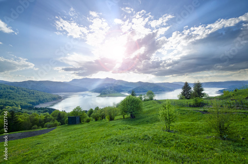 Rural scene of mountain and lake at summer