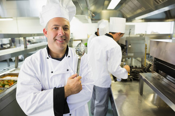 Experienced male chef posing in a kitchen