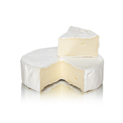 Round camembert cheese with a cut out piece
