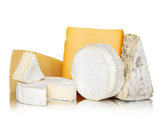Variety of cheese isolated on white background with reflection