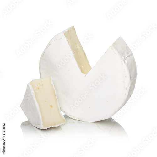 Staande foto Zuivelproducten Round camembert cheese with a cut out piece