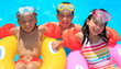Kids floating in swimming pool