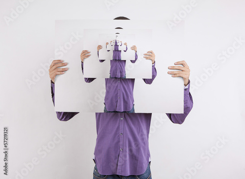man holding picture of himself to infinity