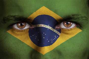 brazil, brazilian flag painted on the face of young man