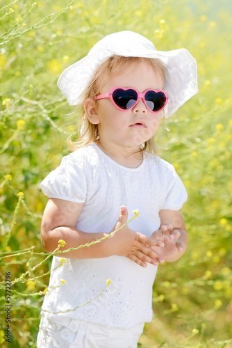 toddler in the yellow rape field