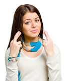 Youngster wearing colored scarf with her fingers crossed poster