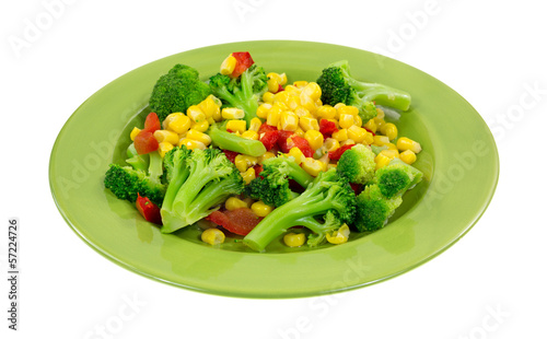 Cooked vegetables on a green plate