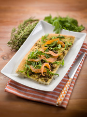 focaccia with smoked salmon arugula and rosemary, selective focu