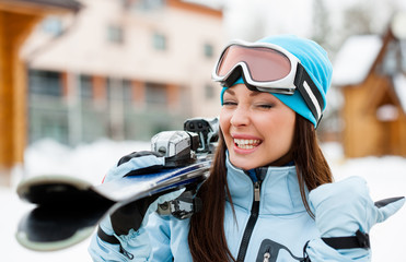 Close up of girl who hands skis and thumbs up