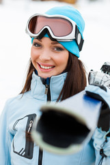 Portrait of female who hands skis