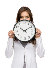 Half-length portrait of woman keeping clock, isolated