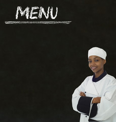 Chef with chalk menu sign on a blackboard background