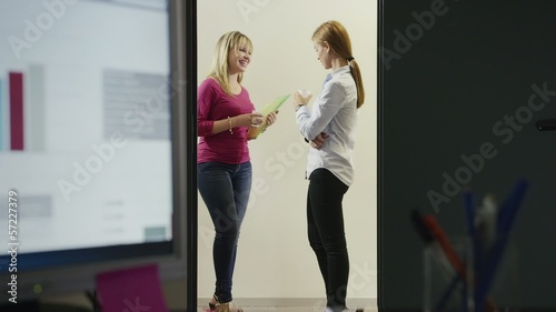 team of business women working in office at night