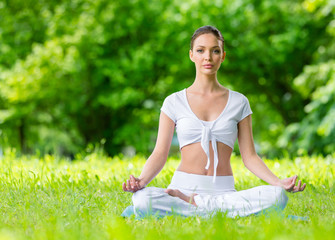 Woman sits in lotus position zen gesturing