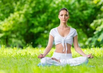 Woman sits in lotus position zen gesturing