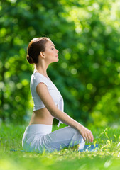 Profile of woman who sits in lotus position
