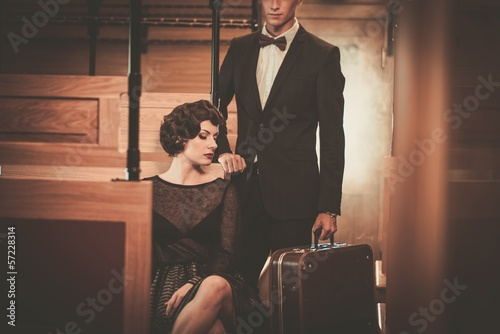 Beautiful vintage style couple inside retro train coach