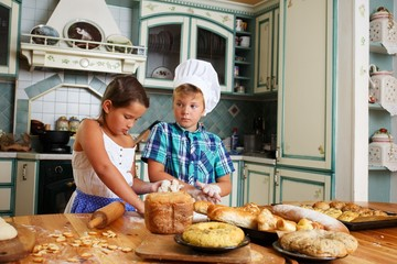 Happy children cooking homemade pastry
