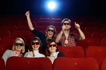 Group of people in 3D glasses watching movie in cinema