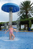 Child girl in tropical swimming pool